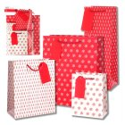 essential Waitrose red snowflake gift bags - 4s